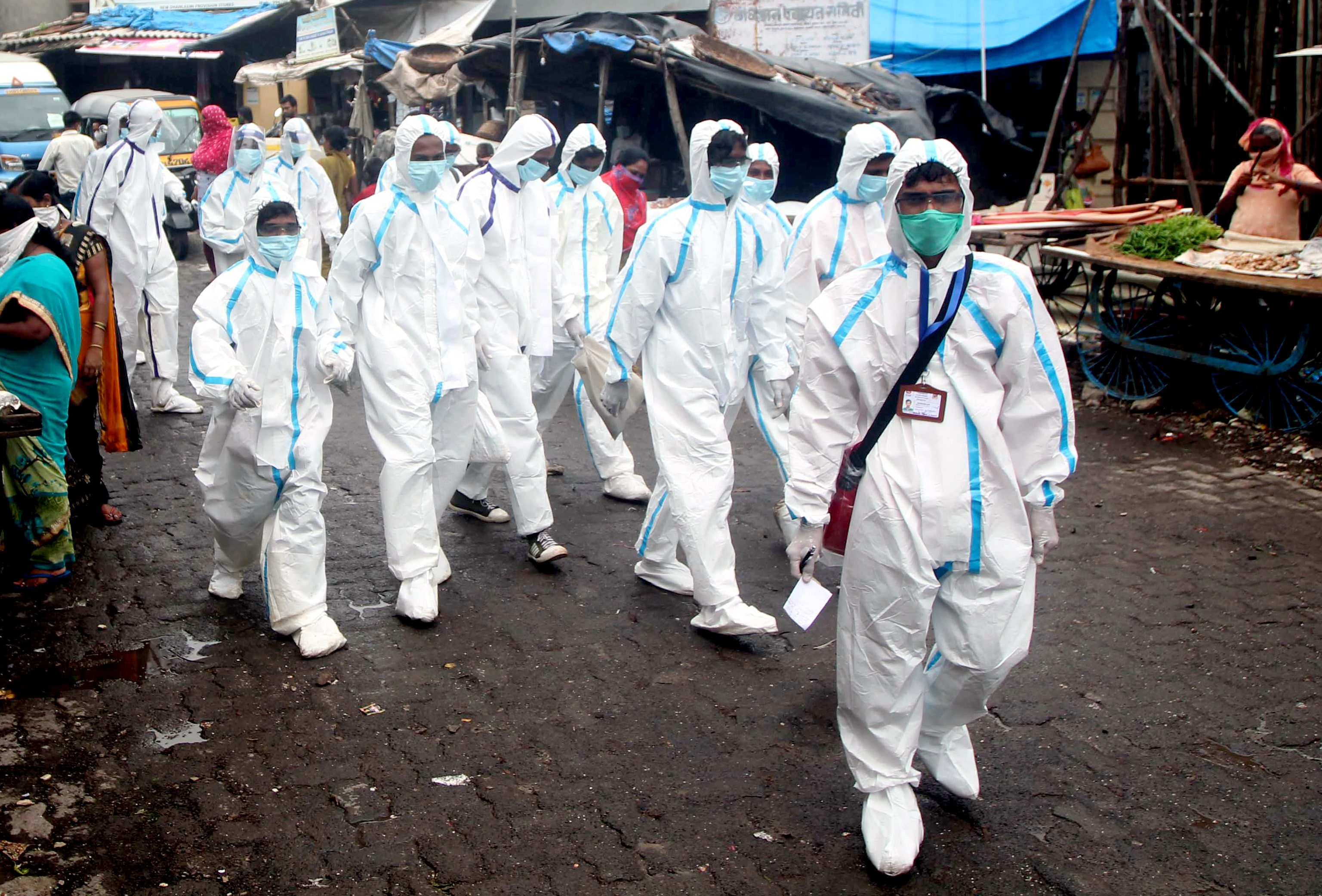 Health workers wearing PPE to carry out medical checkup of the residents of a 'containment zones' Ambujwadi slums area at Malad, a Covid-19 hotspot, in Mumbai.