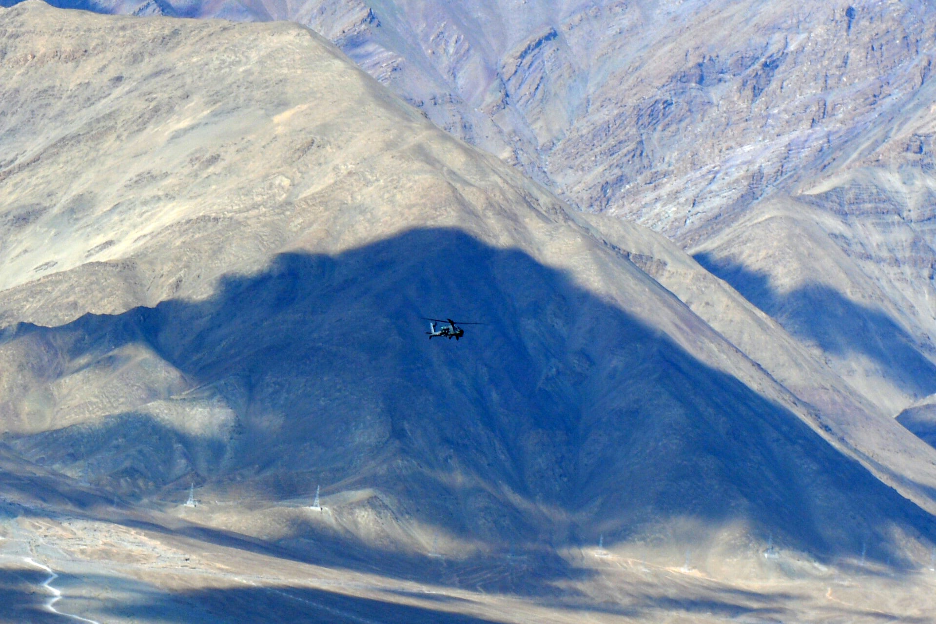 An Indian Air Force Apache helicopter is seen against the backdrop of mountains surrounding Leh on Thursday.