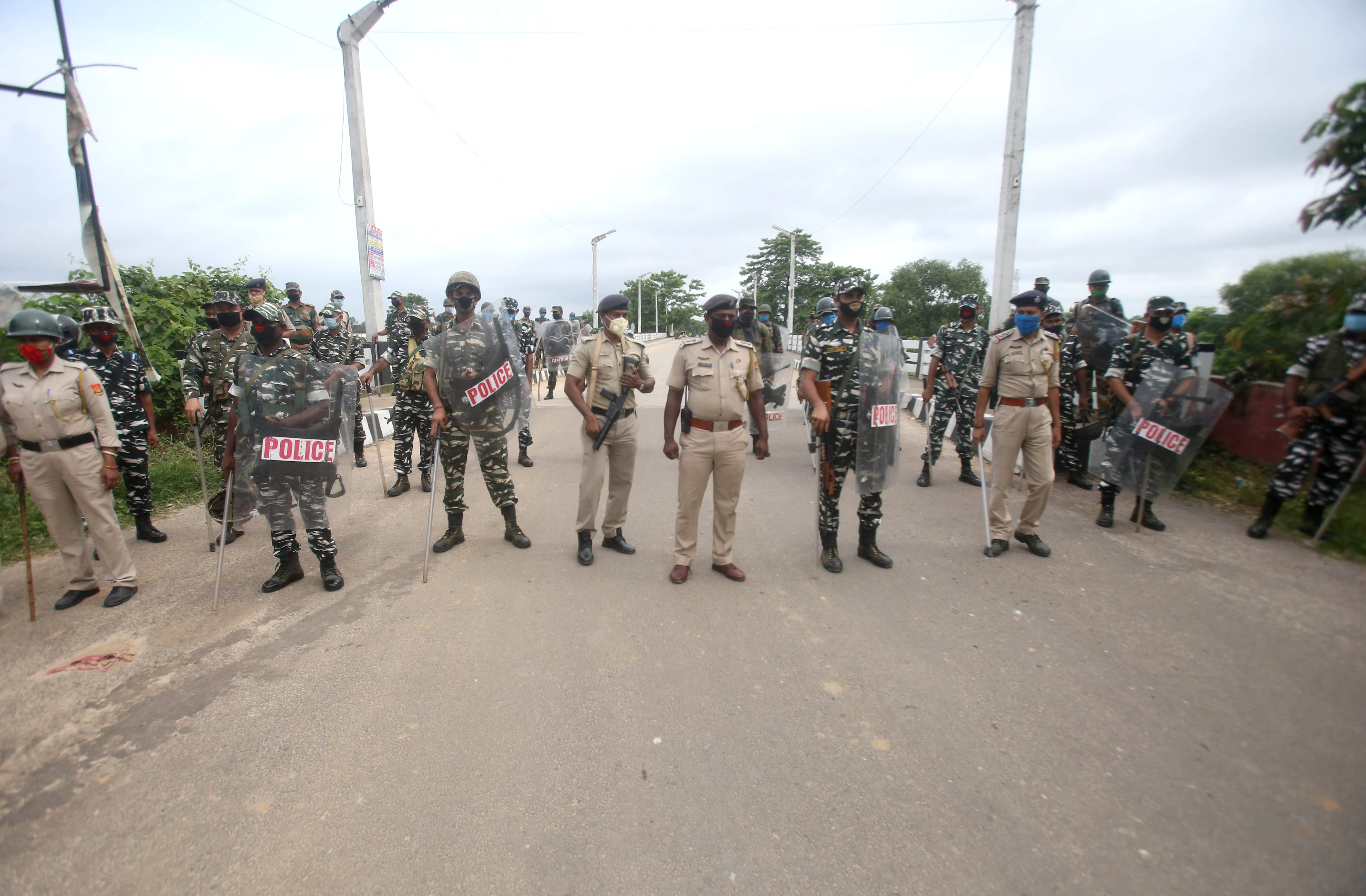 Police personnel stand guard as Indigenous Peoples' Front of Tripura (IPFT) has called for a 24-hour strike against the arrest of a party worker, at Khumulwng in Agartala on Thursday.