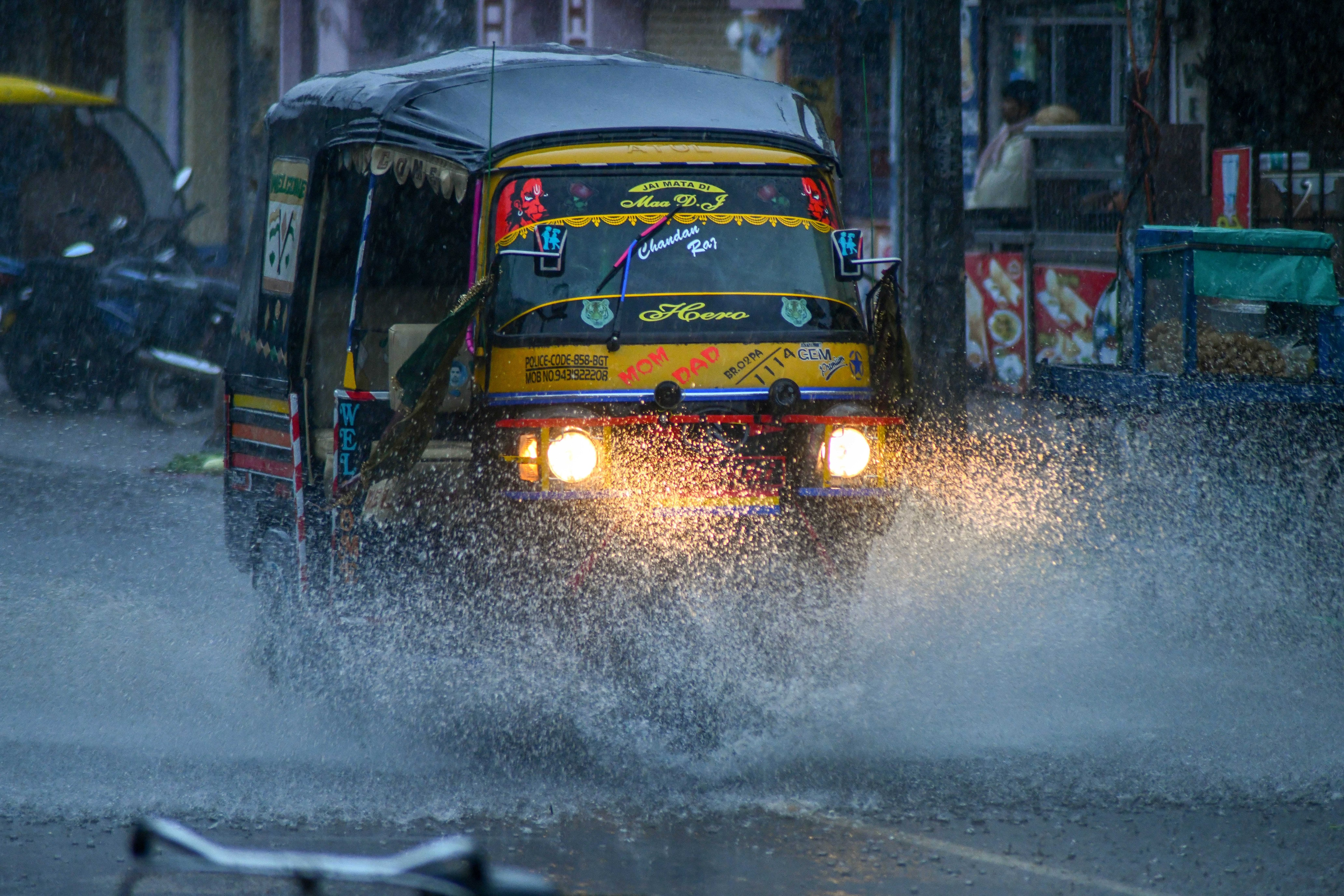 An Auto rickshaw running on the road during heavy rainfall, in Bodhgaya on Friday. Photo: ANI