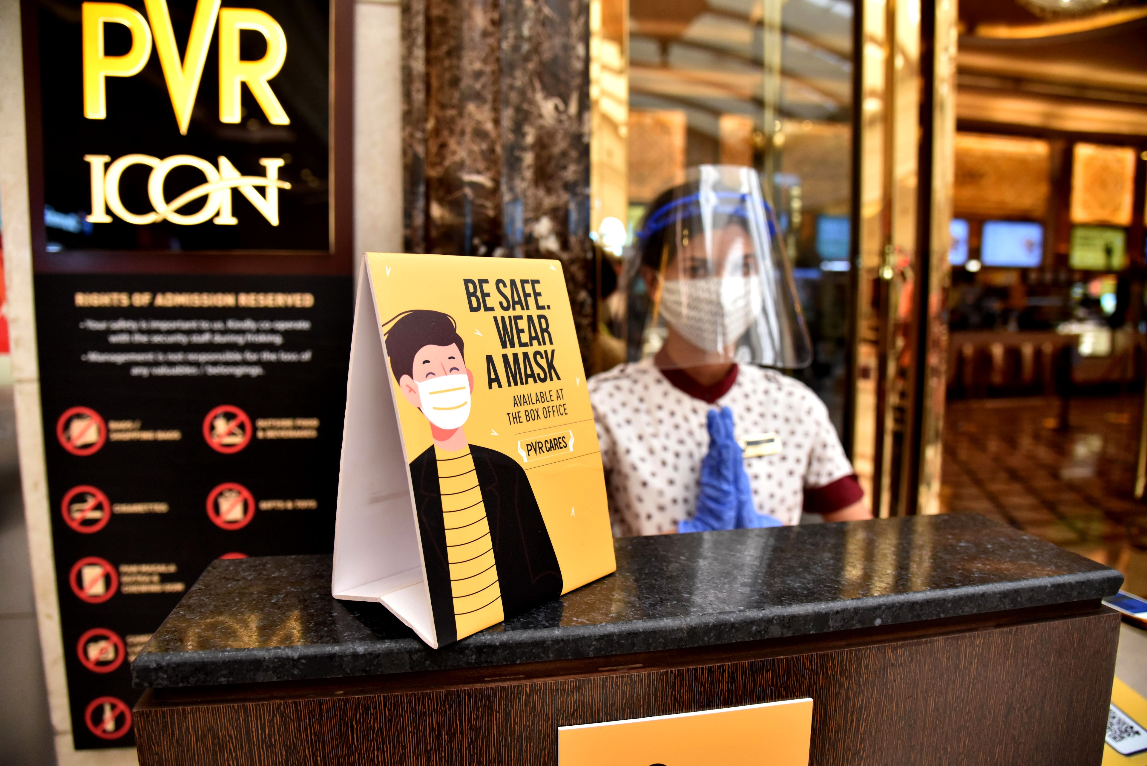 PVR Cinemas employee wearing face shield and facemask seen at PVR ICON, DLF Promenade Mall, Vasant Kunj, in New Delhi on Friday.
