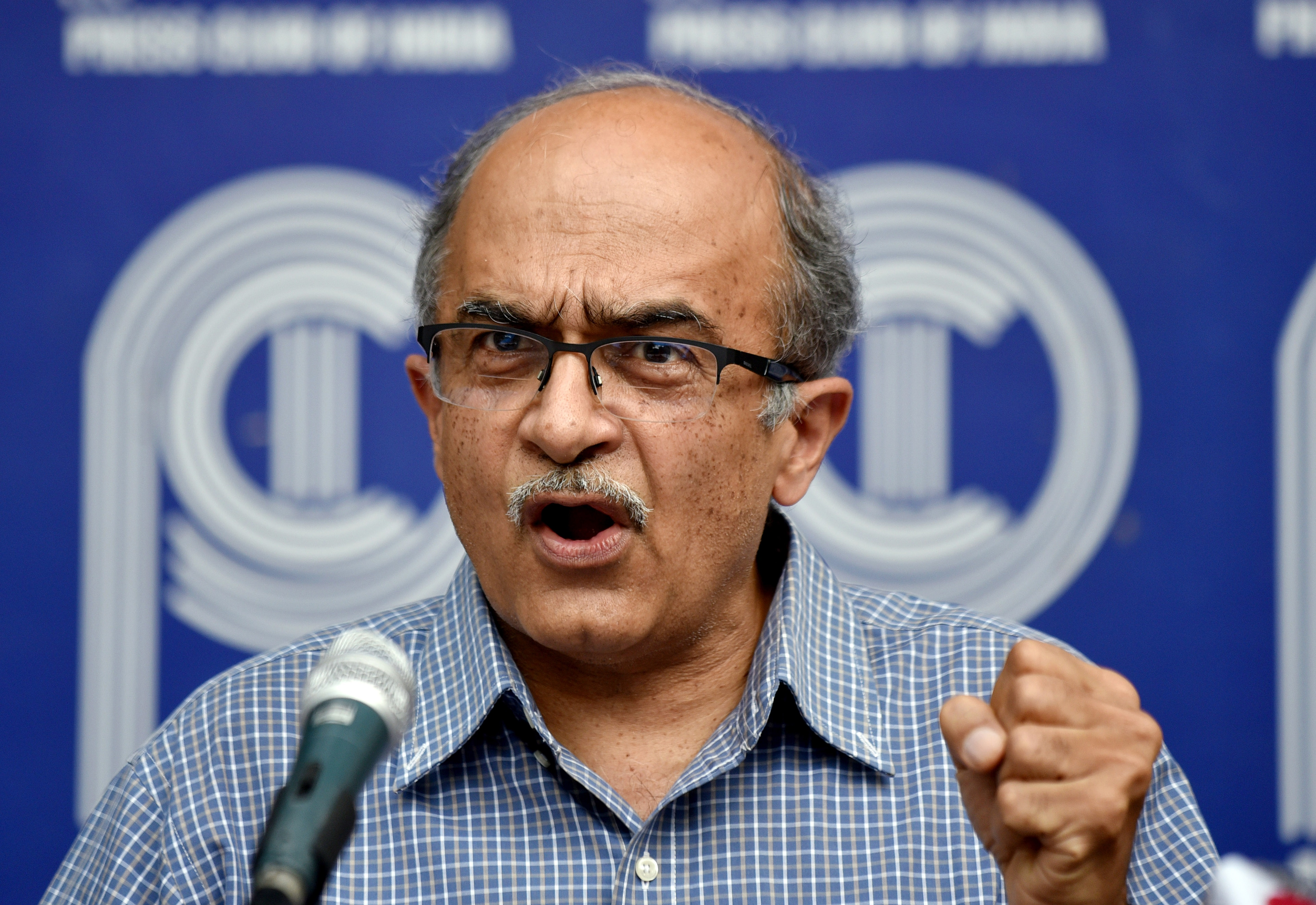 Advocate Prashant Bhushan addresses a press conference at the Press Club of India, in New Delhi.