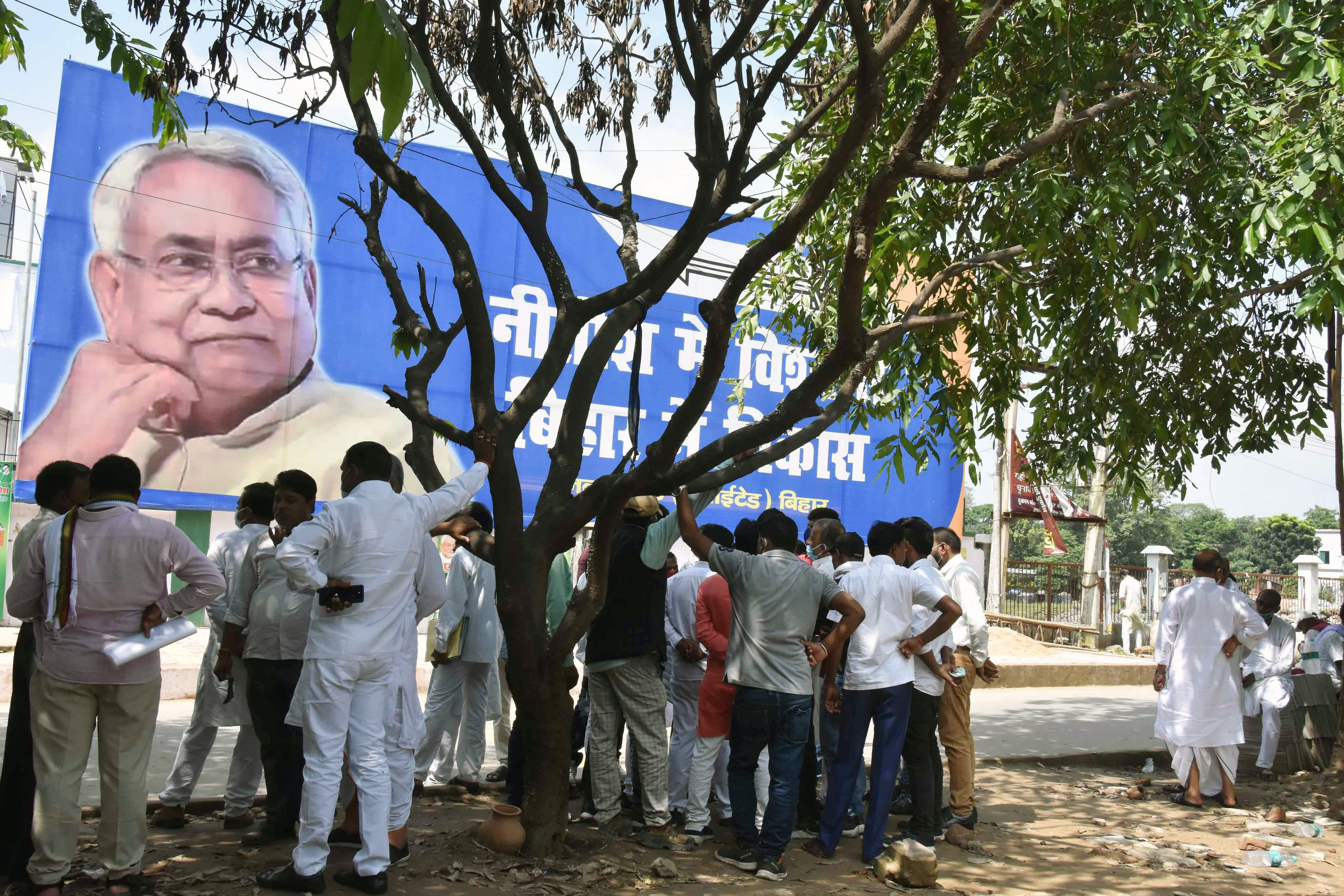 Ticket seekers wait outside JD(U) office to meet Bihar chief minister Nitish Kumar for the upcoming Bihar assembly elections in Patna.