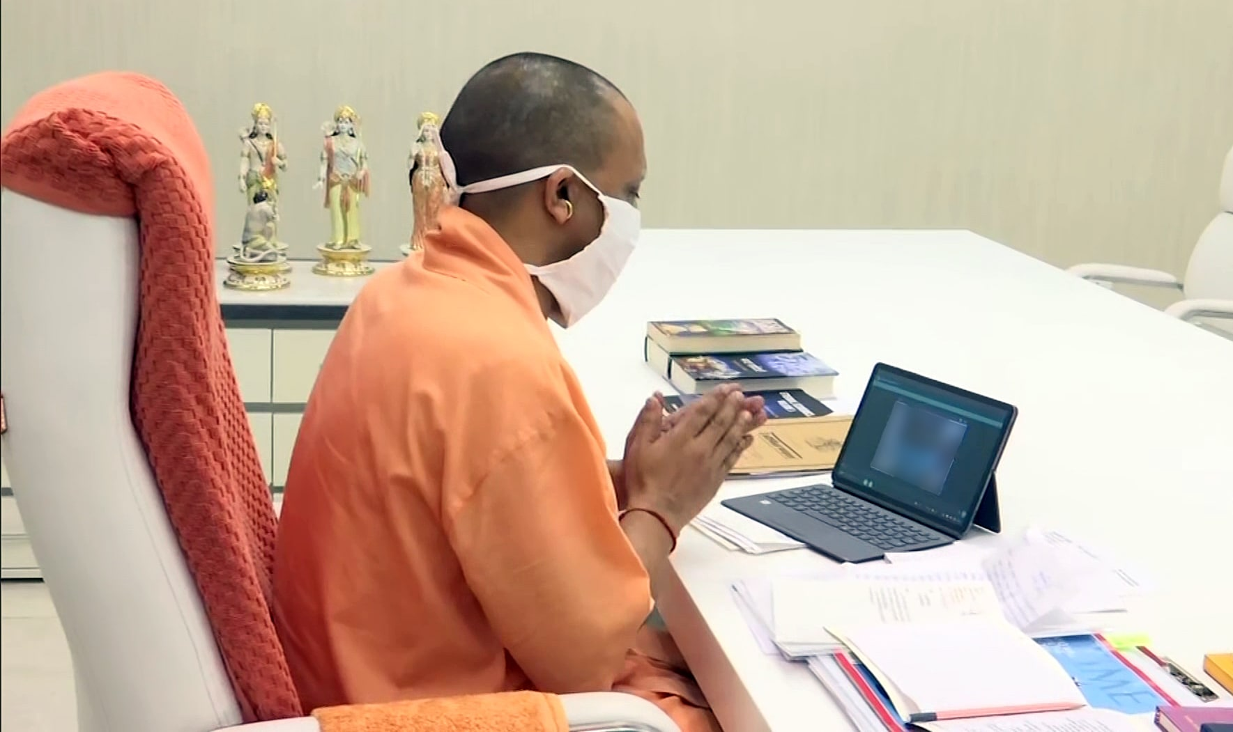 Uttar Pradesh Chief Minister Yogi Adityanath speaks to the family of Hathras gang-rape victim, via video conferencing, in Lucknow.