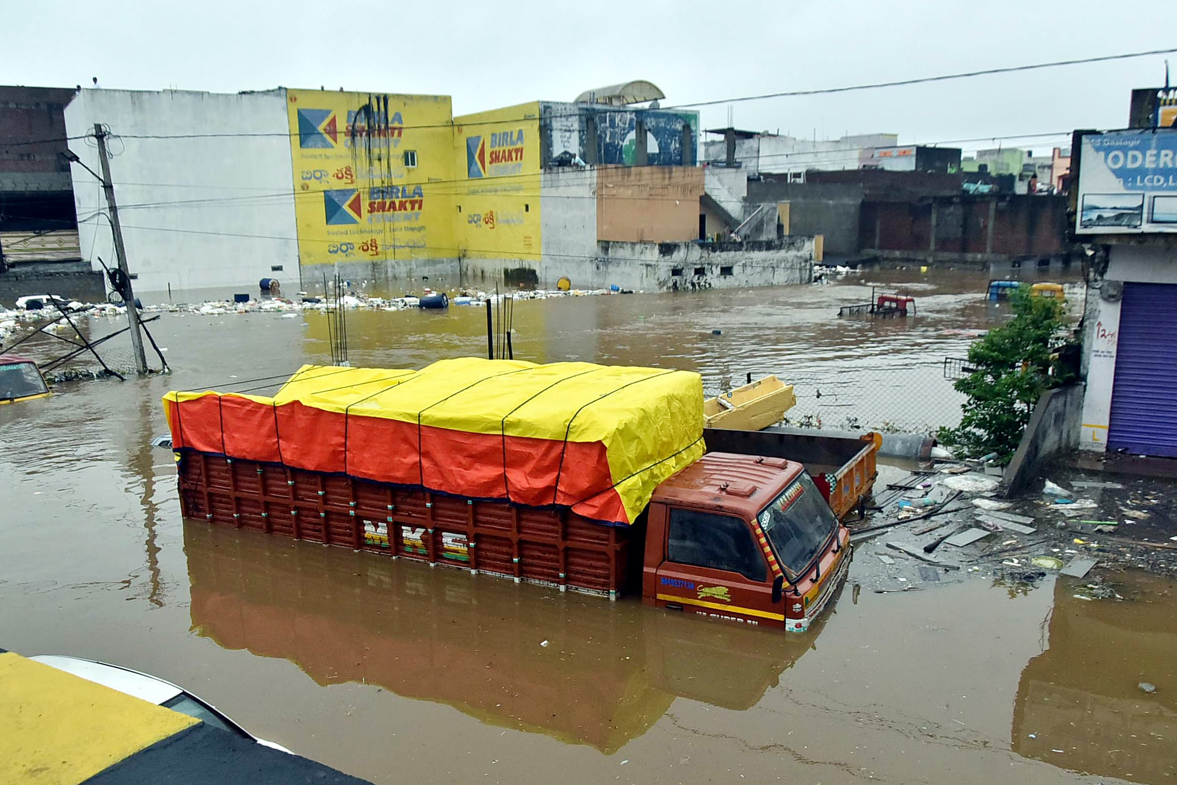 A truck submerges in water following heavy rainfall at Falaknuma area in Hyderabad on