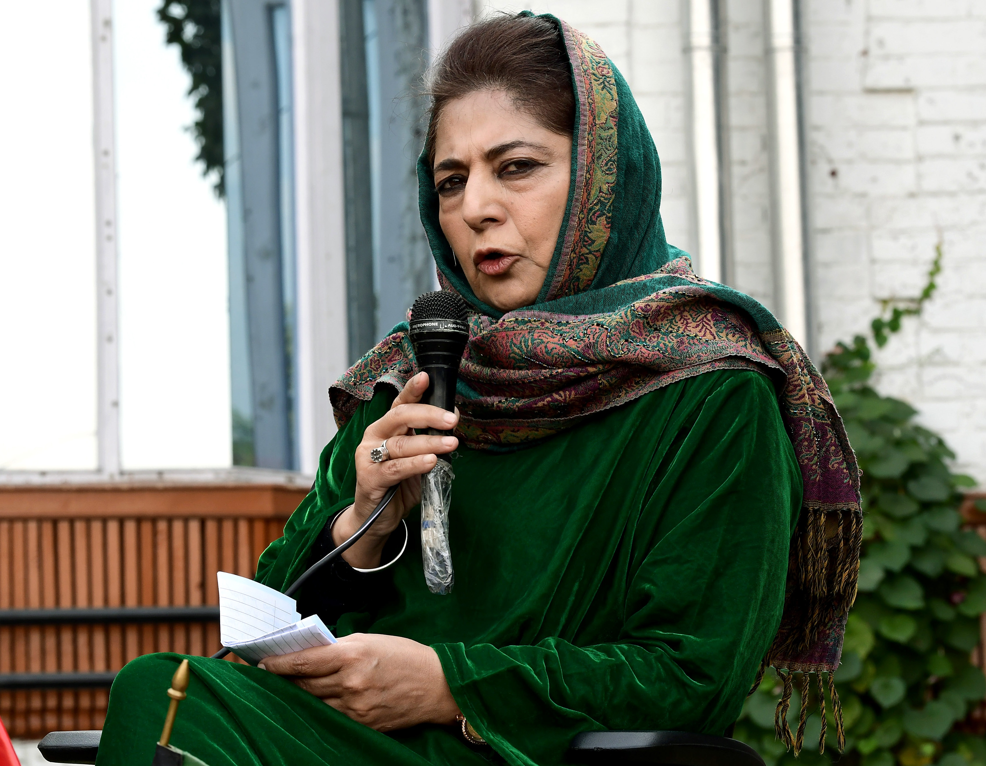 PDP President Mehbooba Mufti addressing media during a press conference at her residence in Srinagar.