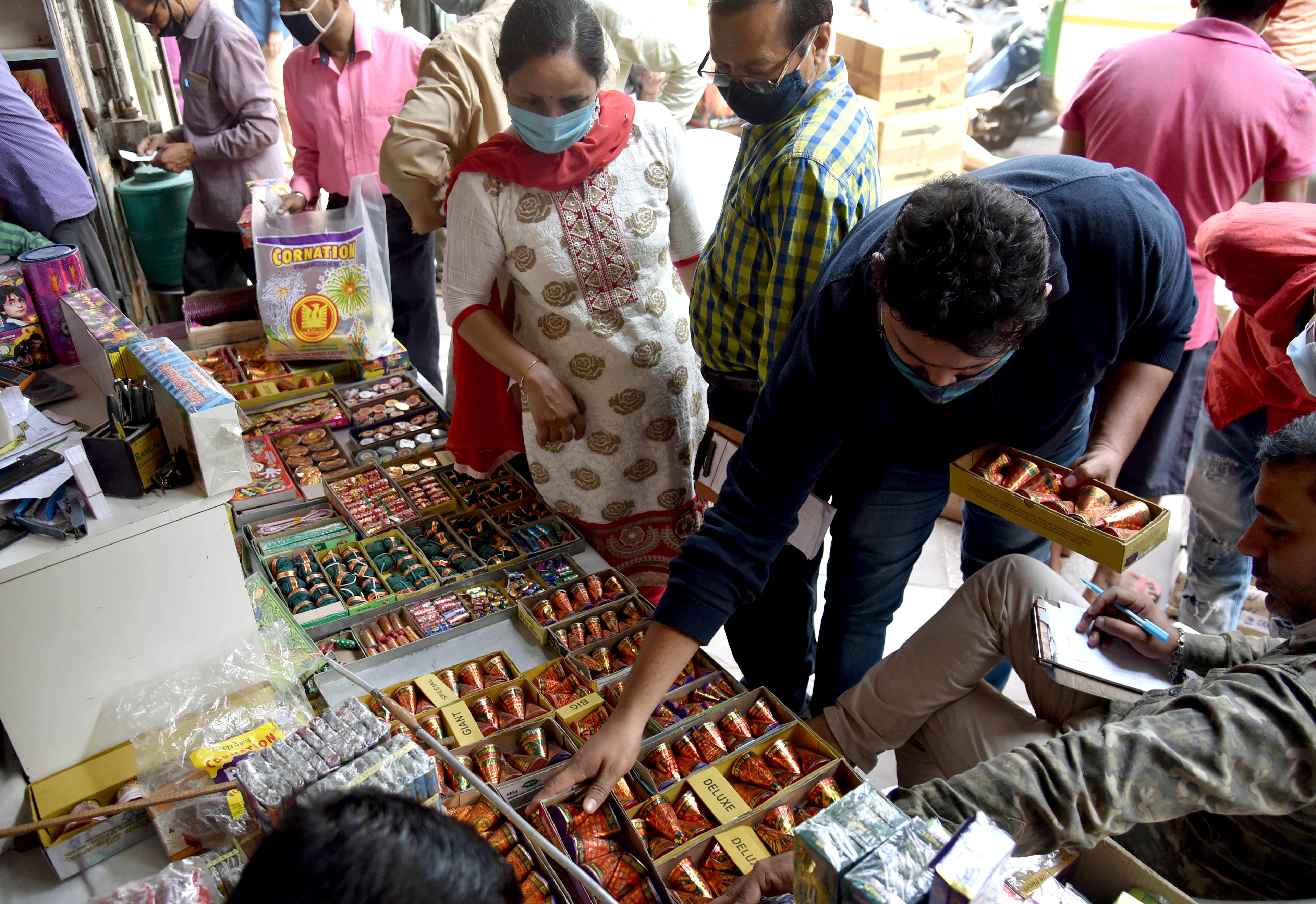 People buying green crackers ahead of Diwali Festival in Old Delhi on Friday.