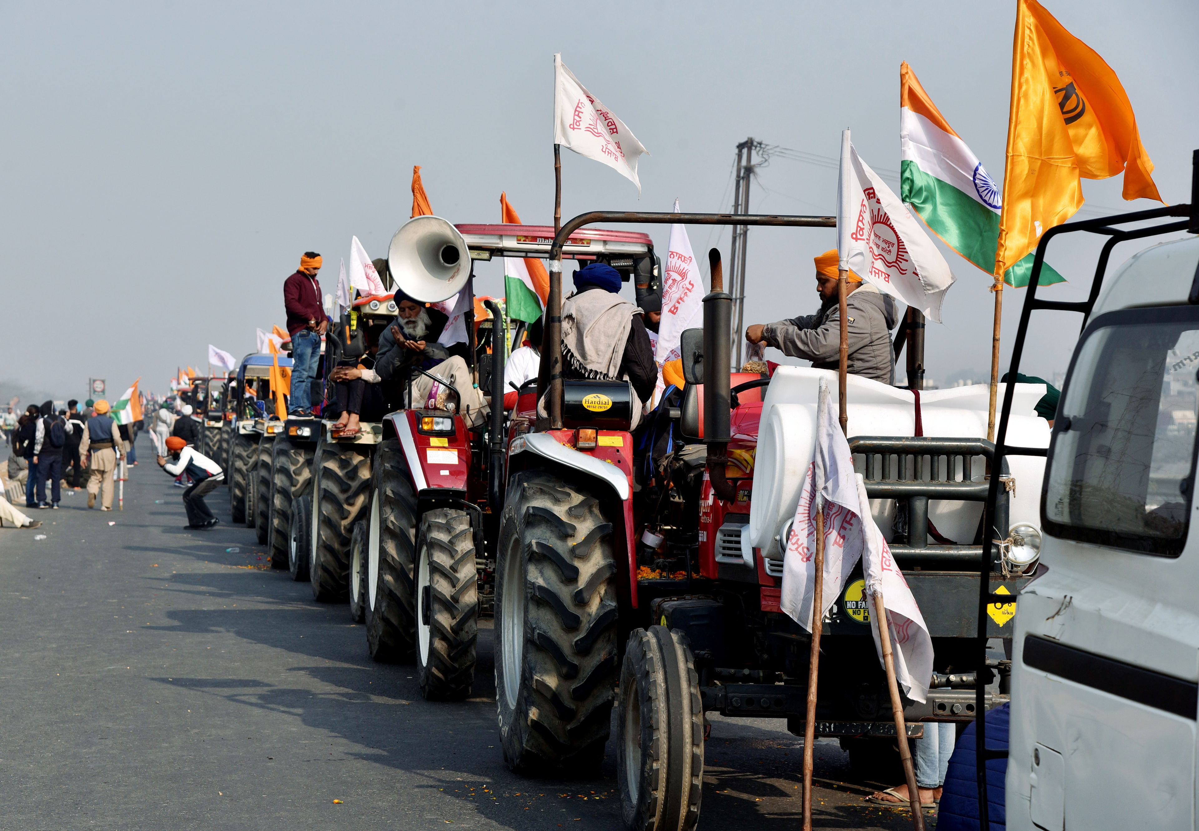 Tractors are seen during farmers' rally against the new farm laws at Mukarba Chowk near Singhu border in New Delhi