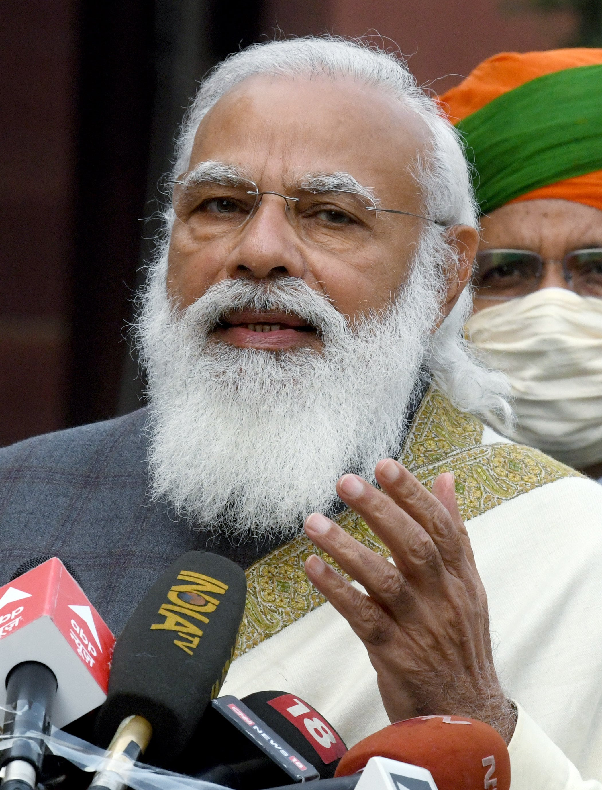 Prime Minister Narendra Modi arrives to address media before the Budget Session of Parliament, in New Delhi on Friday.