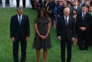 Obama, Michelle observe a moment of silence