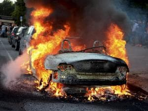A car burns during a protest against the upcoming G20 summit in Hamburg. The leaders of industrialised nations, G20, are holding a two day summit starting Friday