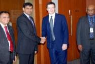 Osborne shakes hands with Raghuram Rajan
