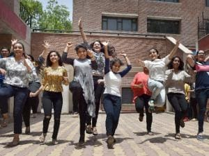 Students celebrate their success after the announcement of CBSE class 12th results in Amritsar on Sunday