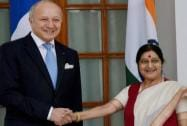 Swaraj shakes hands with Foreign Minister of France