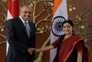 Swaraj shakes hands with K. Shanmugam