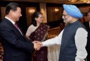 Manmohan Singh greets Xi