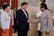 Xi shakes hands with Ram Madhav