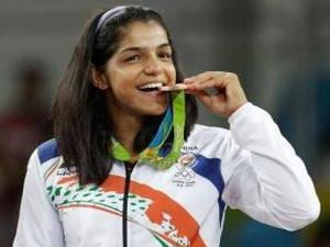 Sakshi Malik poses with her bronze medal at the Rio Olympics