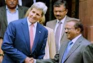 John Kerry shakes hands with Ajit Doval