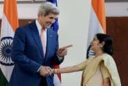 Sushma Swaraj shakes hands with John Kerry