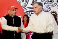 Fenandes shakes hands with Ratan Tata