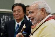 Modi tries his hand at playing a flute