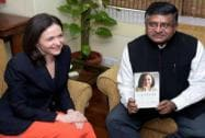 Sandberg presents copy of her book to Prasad