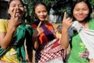 Young girls show their marked fingers after casting votes in Mizoram