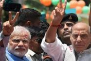 Narendra Modi with BJP President Rajnath Singh waves victory sign to the supporters