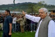 Mufti Mohmmad Sayeed waves to party workers during an  election rally in Baramulla district
