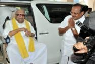 M Karunanidhi arrives at an election campaign rally in Coimbatore