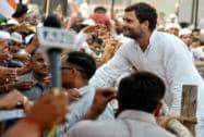 Rahul Gandhi meets the crowd during an election campaign rally in Mirzapur