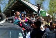 Mehbooba Mufti welcomed by her party supporters during an election road show in Baramulla