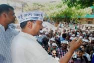 Arvind Kejriwal interacts with school children during an election campaign in Varanasi
