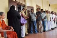 Voters stand in queue to cast their votes during  re- polling in Kochi