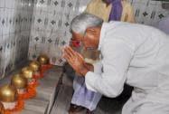 Nitish Kumar worshipping at a temple in Kalyanbigha in Patna