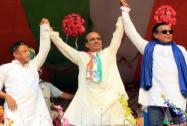 Dinesh Trivedi (C) along with Mithun Chakraborty (R) and Mukul Roy during an election rally