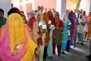 Women at a polling booth in Haryana