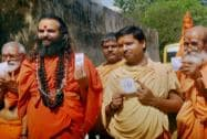 Sadhus after casting their votes for the last phase of Lok Sabha elections in Varanasi