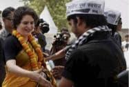 Priyanka Vadra shakes hands with AAP workers