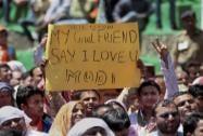 A BJP supporter holds placard praising Modi