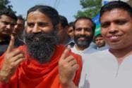 Baba Ramdev shows his inked finger