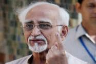 Hamid Ansari shows his ink-marked finger