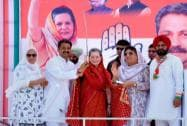 Sonia Gandhi is presented a sword by party candidate Vijay Inder Singla in Barnala