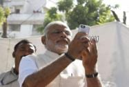 Modi votes, clicks selfie