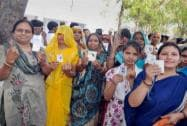 Woman voters show their identity cards