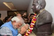 Narendra Modi pays tribute to a statue of Deen Dayal Upadhyaya