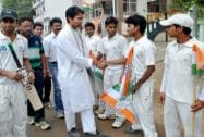 Mohammad Kaif meeting local cricket players during his door-to-door election campaign