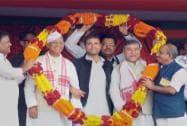 Rahul Gandhi is garlanded along with Tarun Gogoi in Assam