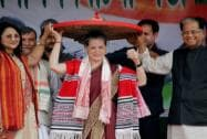 UPA Chairperson Sonia Gandhi being felicitated with traditional Assamese Japi